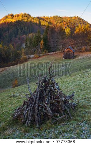 Autumn landscape. Firewood Meadow. Morning in a mountain village. Wooden shed. Carpathians, Ukraine, Europe