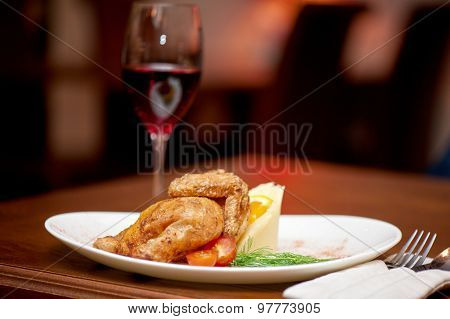 Dinner at table and on fireplace background
