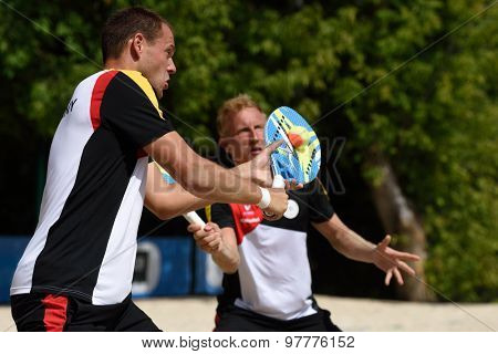 MOSCOW, RUSSIA - JULY 17, 2015: Benjamin Ringlstetter (left) and Nils Muschiol of Germany in the match of the ITF Beach Tennis World Team Championship against Italy. Italy won the match 3-0