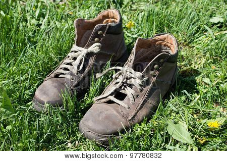 Boots On Grass Background/a Vintage Boots On Grass