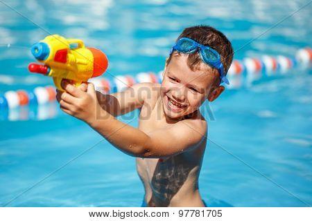 Little Boy Shooting With Water Gun