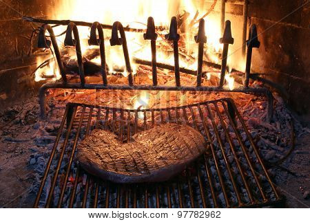 Beef Steak Cooked On The Barbeque Fireplace With Flame