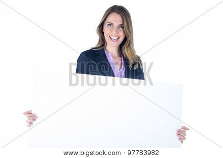 Businesswoman posing with a blank sign on a white background