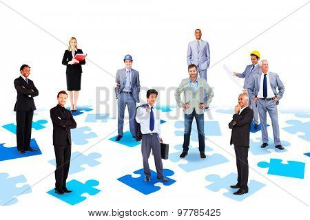 Business team against blue jigsaw pieces