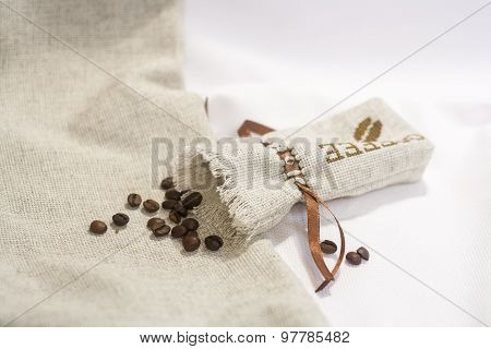 Sachet with embroidery stitch with coffee beans