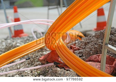 Orange Pipes For Fiber Optics In A Large City Road Construction