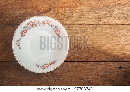 Old White Ceramic Dish On Wood Background
