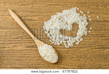 Uncooked Japanese Rice In A Wooden Spoon