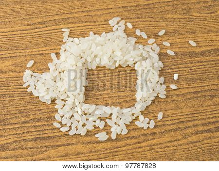 Uncooked Japanese Rice On A Wooden Table