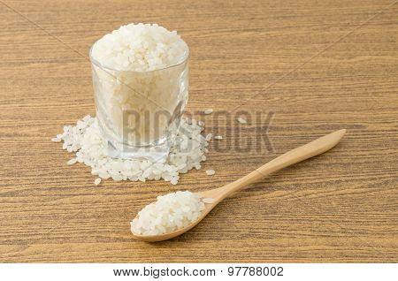 Japanese Rice In Wooden Spoon And Glass Cup