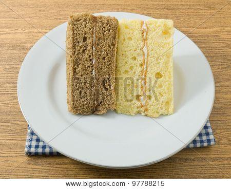 Vanilla And Coffee Chiffon Cake On A White Dish