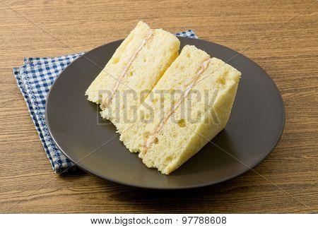 Vanilla Chiffon Cake On A Black Dish