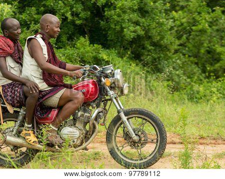 Maasai Tribesmen Riding A Motorbike
