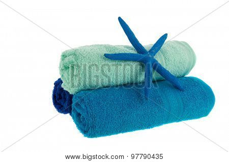 Blue rolled towels with starfish isolated over white background