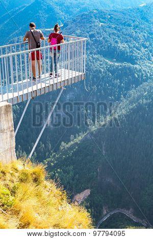 People Taking Photo At Panoramic Mountain Viewpoint Eagle Eye, Orlovo Oko In Rhodope