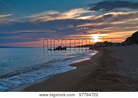 Waves on a sandy beach at sunset, west coast of Sithonia
