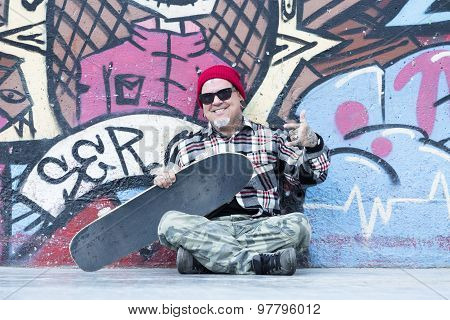 Portrait Of An Old Man Skater Sitting