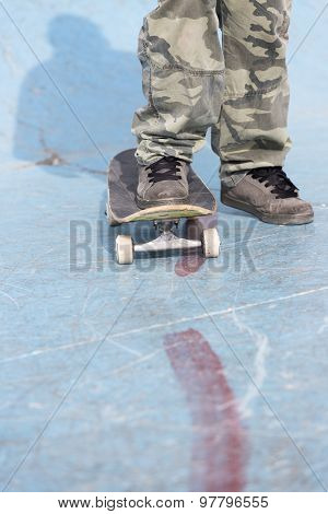 Skater Foot Over A Skateboard