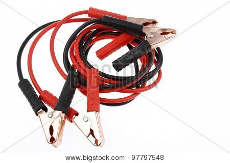 Jumper cables on plain background