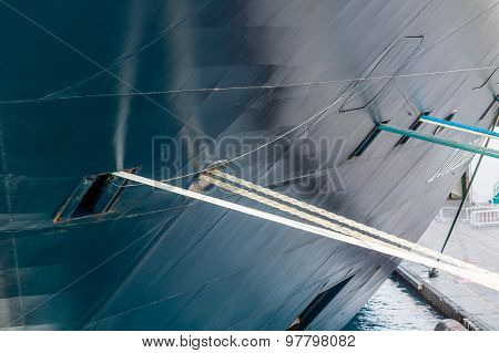 Ropes Running From Hull Of Ship