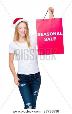Woman hold with shopping bag and showing seasonal sale