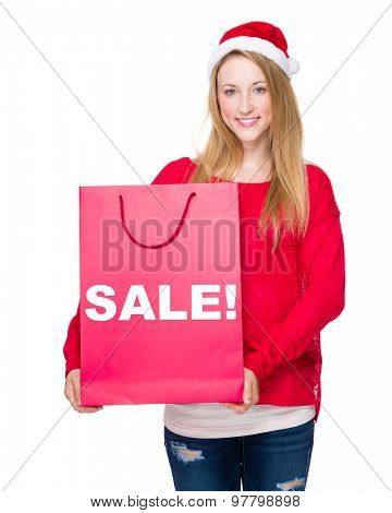 Christmas party Woman with red paper bag showing sale!