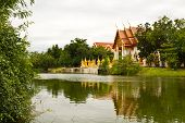 picture of convocation  - Buddhist temple and little stupas behide river foreground with shadow in the water and white background. ** Note: Slight blurriness, best at smaller sizes - JPG