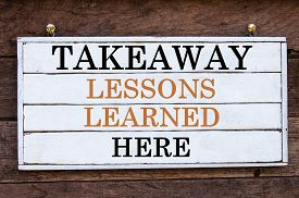 pic of takeaway  - Takeaway Lessons Learned Here Inspirational message written on vintage wooden board - JPG