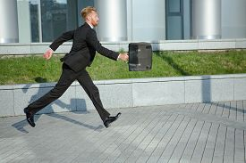 pic of running-late  - Businessman with brief case in hurry - JPG