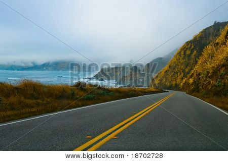 Foggy winding road along California coast