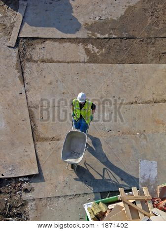 Constructionworker With A Wheelbarrow