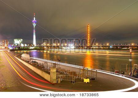 dusseldorf germany-night-scene-includes media-tower and bridge on rhine river