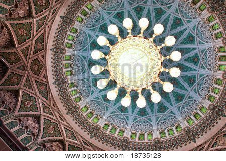 Interior view of dome of Sultan Qaboos Grand Mosque in Muscat, Oman