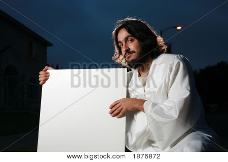 Jesus Holding A Blank White Sign
