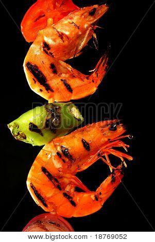 close up of grilled shrimp on skewer