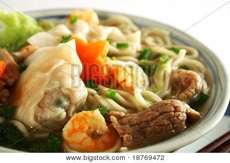 close up of a bowl of hot wanton noodle soup
