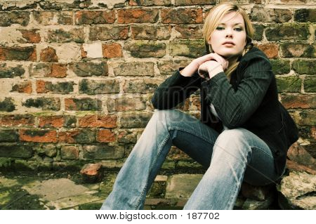 Beautiful Blonde Girl Sitting