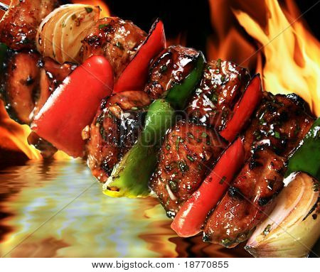 pork barbecue on flaming hot background