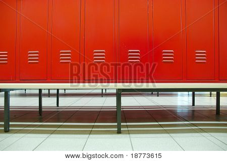 Red doors and bench in a locker room