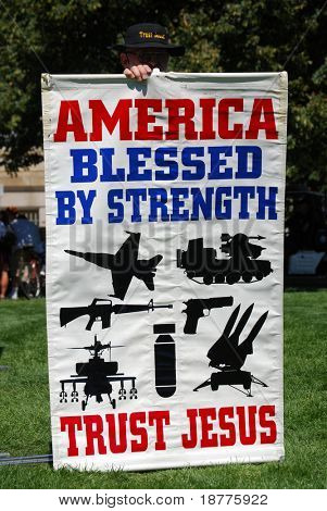 DENVER - AUGUST 26: A religious conservative demonstrator (not shown) holds a sign promoting US military power during the Democratic National Convention on August 26, 2008 in Denver, Colorado.