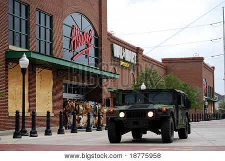 NEW ORLEANS - SEPT 1: National Guard troops in a Humvee guard a Wal-Mart which had been closed and fortified against Hurricane Gustav on September 1, 2008 in downtown New Orleans.