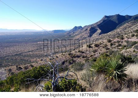 Desert landscape from Miller Peak in Arizona towards a valley on the US-Mexican border, favored by smugglers