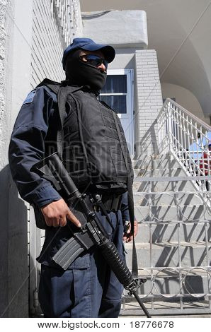 Fully armed and protected special forces soldier on the Mexican side of the US-Mexico border