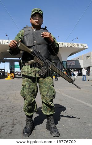 CIUDAD JUAREZ, MEXICO - FEB 27: An army soldier checks vehicles traveling from Mexico to the U.S. on February 27, 2009, on a checkpoint in Ciudad Juarez, Mexico.