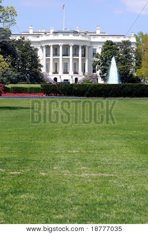 South facade and South lawn of the White House in Washington DC in spring colors, with vertical copyspace on the fresh green lawn