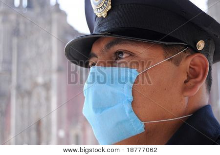 MEXICO CITY - APRIL 29: A police officer wears a face mask as a protective measure against the Swine Flu as he stands guard in front of Catedral Metropolitana on April 29, 2009 in Mexico City.