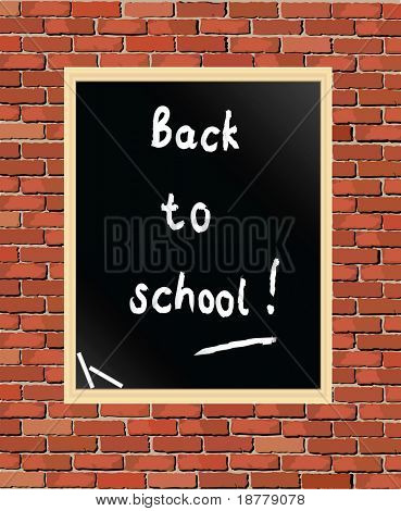 """Back to school"" written on blackboard against brick wall."