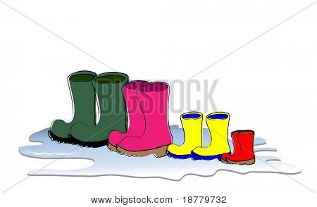 A row of Wellington boots drying. Family sizes, father, mother, child and baby.