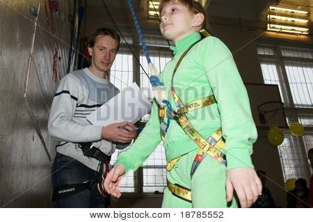 "RUSSIA, MOSCOW - DEC 12: Participants of competitions prepare for performance ""City youthful competitions on climbing sport Winter 2010"" December 12, 2010 in Moscow, Russia"