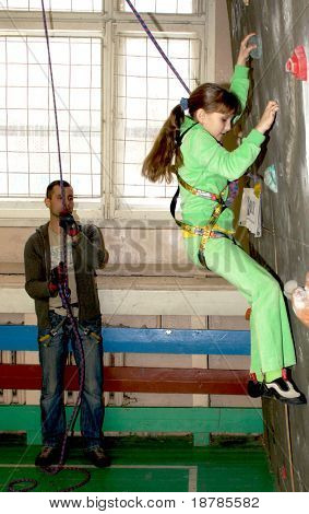 """RUSSIA, MOSCOW - DEC 12: Unidentified Girl climbing on a wall """"City youthful competitions on climbing sport Winter 2010"""" December 12, 2010 in Moscow, Russia"""